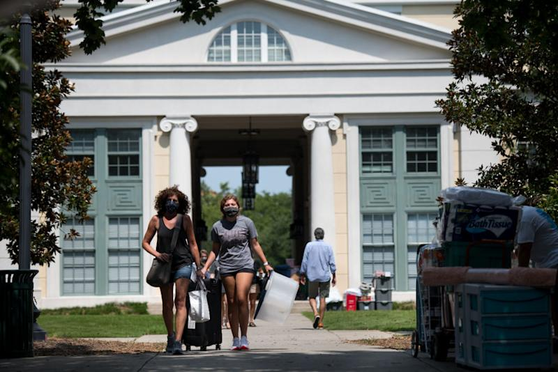Students and their families move belongings at a campus dormitory at the University of South Carolina on August 10, 2020 in Columbia, South Carolina.
