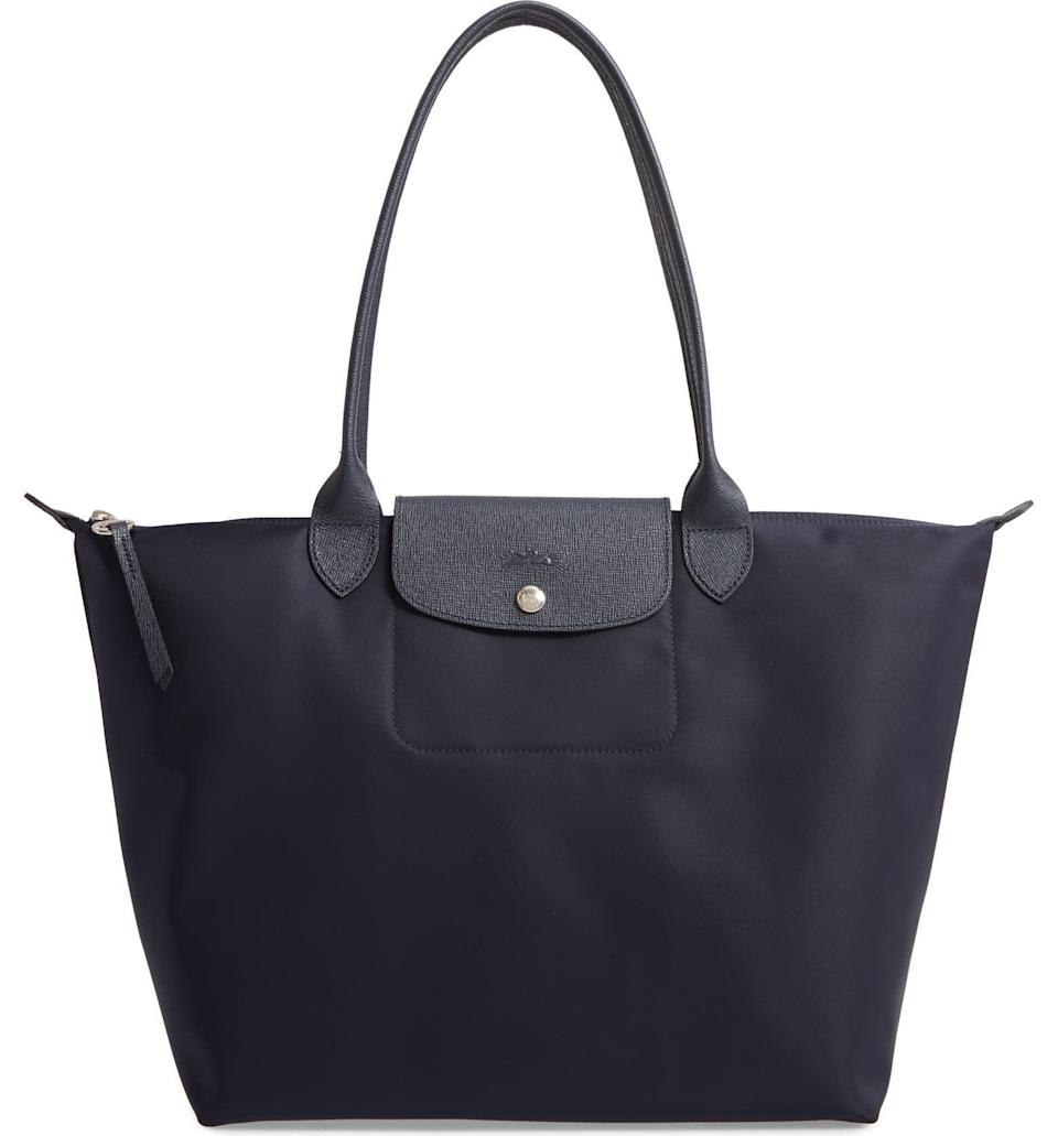 <p>This <span>Longchamp Large Le Pliage Nylon Tote</span> ($190) will quickly become your go-to, thanks to the size and the ease of carrying. It's big enough for not just your essentials but also your laptop, magazine, and notebook.</p>