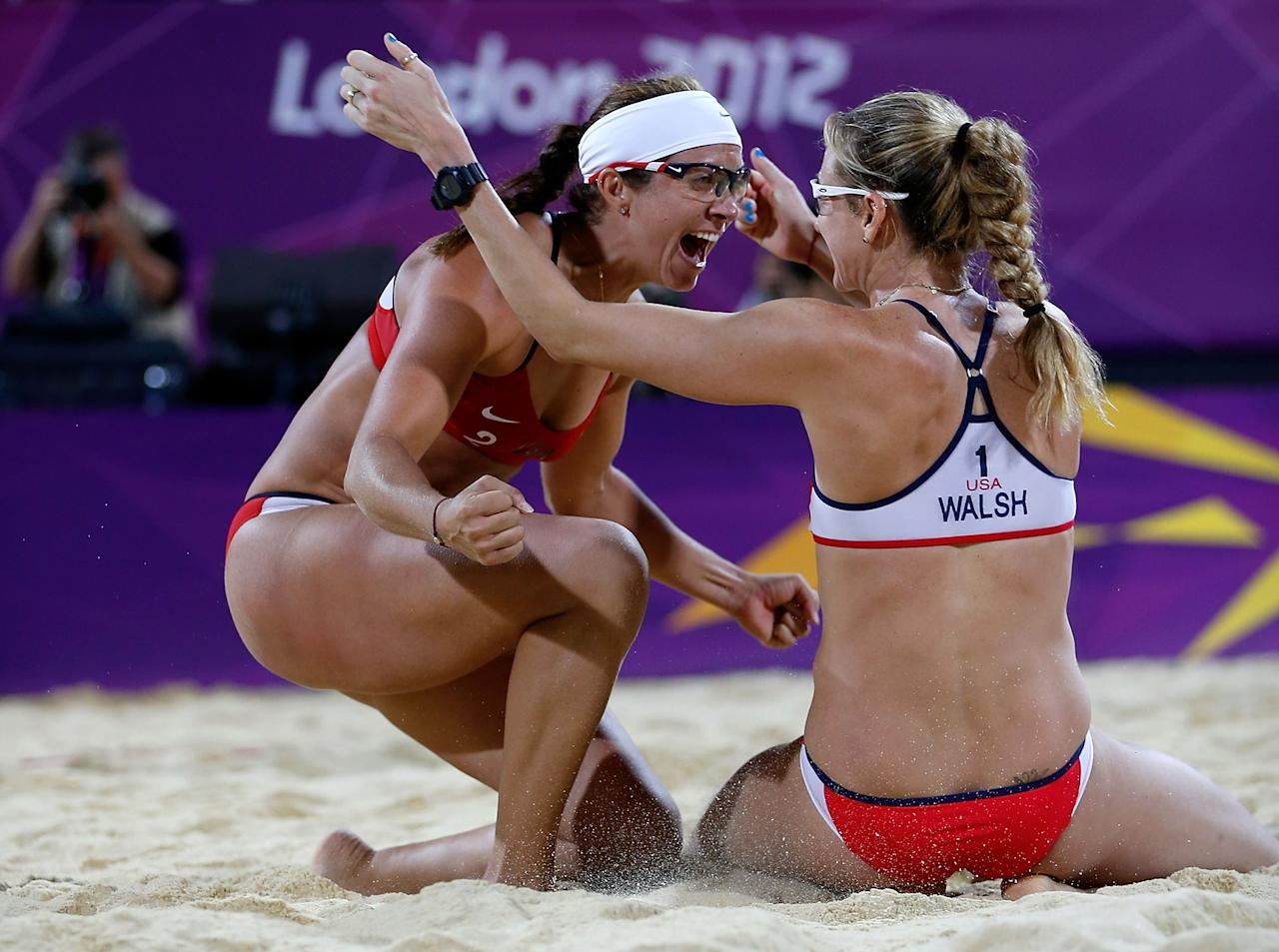 LONDON, ENGLAND - AUGUST 08:  Kerri Walsh Jennings (R) and Misty May-Treanor of the United States celebrate winning the Gold medal in the Women's Beach Volleyball Gold medal match against the United States on Day 12 of the London 2012 Olympic Games at the Horse Guard's Parade on August 8, 2012 in London, England.  (Photo by Jamie Squire/Getty Images)