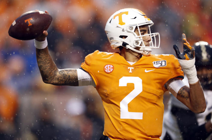 Tennessee quarterback Jarrett Guarantano (2) throws to a receiver in the first half of an NCAA college football game against Vanderbilt, Saturday, Nov. 30, 2019, in Knoxville, Tenn. (AP Photo/Wade Payne)