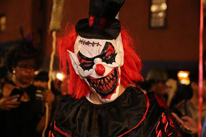 A reveler wears a scary clown mask during the Halloween Parade in New York City Thursday night. (Photo: Gordon Donovan/Yahoo News)