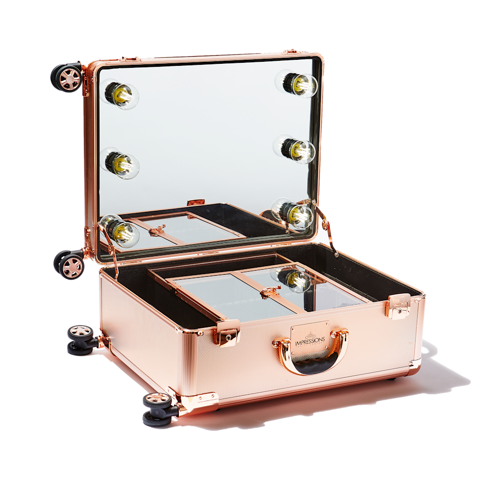 "<p>Yes, this rose-gold tinted Slaycase XL Vanity Travel Case is the epitome of extra. But getting — and staying — organized brings me joy. I think <a href=""https://www.allure.com/story/marie-kondo-interview-konmari-organizing-favorite-beauty-products?mbid=synd_yahoo_rss"" rel=""nofollow noopener"" target=""_blank"" data-ylk=""slk:Marie Kondo"" class=""link rapid-noclick-resp"">Marie Kondo</a> would approve. This rolling suitcase is constructed with tiered, detachable compartments to keep everything in its place. The star of the show is its built-in mirror framed by frosted, Hollywood-style lightbulbs for looks that will truly <em>illuminate</em> your artistic potential. Just plug your case into any outlet and get ready to primp anytime, anywhere.</p> <p><em>Note: The rose-gold version is currently sold out, so the below link goes to the black and rose-gold-accented case.</em></p> <p><strong>$369</strong> (<a href=""https://impressionsvanity.com/products/0-slaycase-xl-vanity-travel-case-in-black-rose-gold"" rel=""nofollow noopener"" target=""_blank"" data-ylk=""slk:Shop Now"" class=""link rapid-noclick-resp"">Shop Now</a>)</p>"