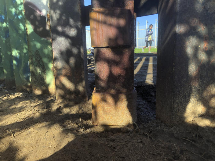"""Smugglers allegedly cut a roughly 18-inch (1.2-meter) opening in the steel-pole of a border wall, since repaired, a breach that the U.S. Border Patrol said led to the """"unintentional destruction"""" of a cross-border garden earlier this month in Friendship Park, located within California's Border Field State Park, in San Diego, Saturday, Jan. 25, 2020. The U.S. Border Patrol gave activists no warning this month after the breach believed to be by smugglers when it bulldozed the U.S. side of the cross-border garden which overlooks the Pacific Ocean. On Saturday, after a public apology for """"the unintentional destruction,"""" the agency allowed the activists in a highly restricted area to resurrect the garden. (AP Photo/Elliot Spagat)"""