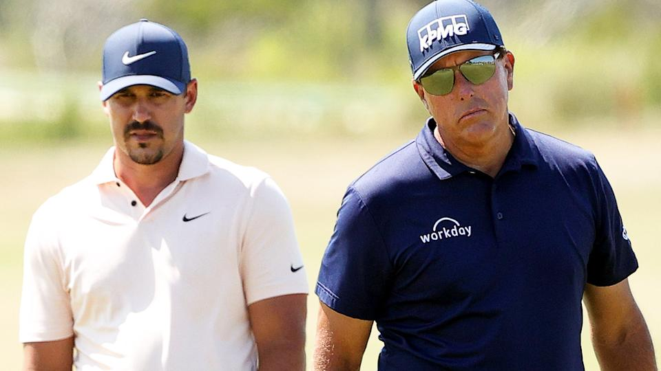 Brooks Koepka and Phil Mickelson, pictured here during the final round of the PGA Championship.