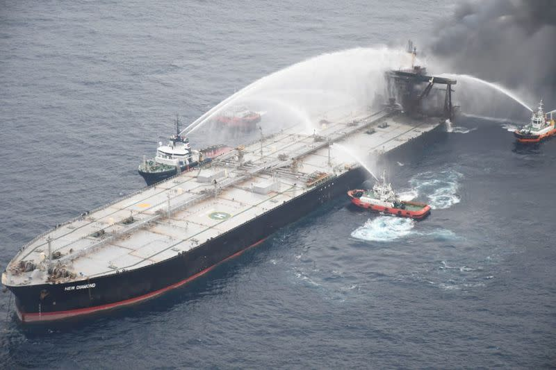 Salvage team working to stop fuel leak from fire-hit supertanker