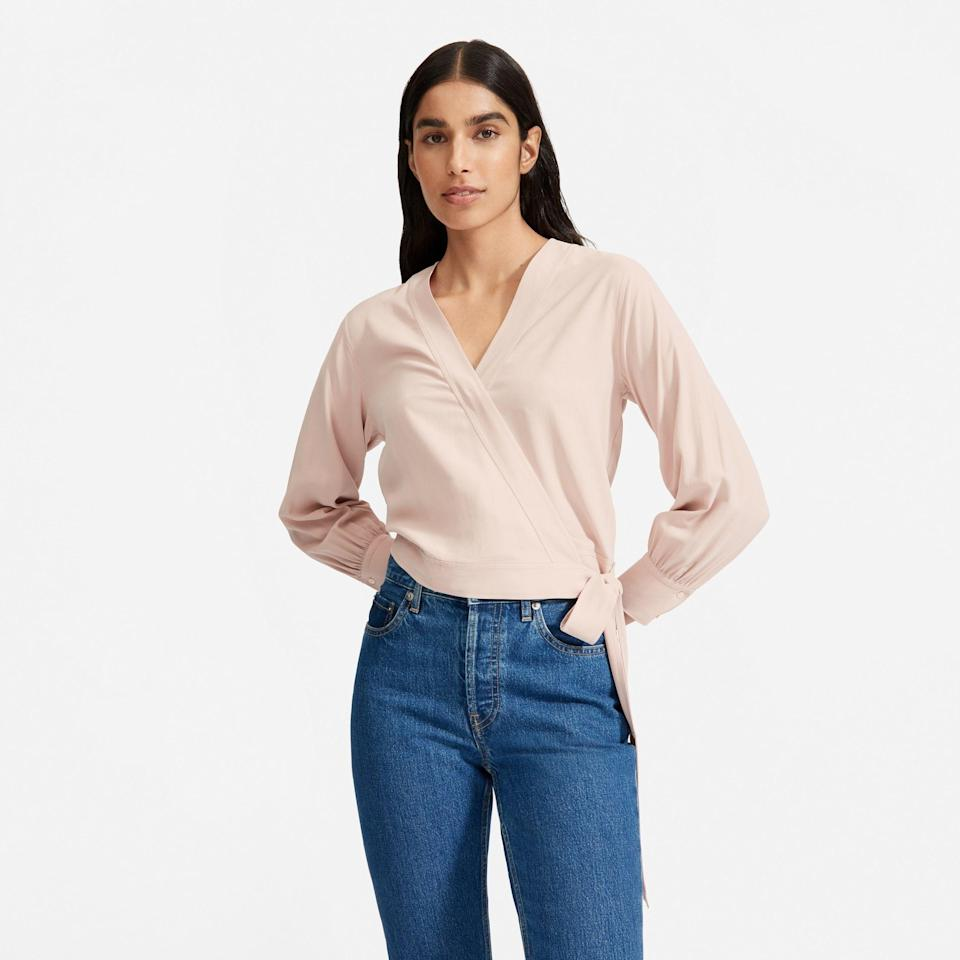 """<p><strong>everlane</strong></p><p>everlane.com</p><p><a href=""""https://go.redirectingat.com?id=74968X1596630&url=https%3A%2F%2Fwww.everlane.com%2Fproducts%2Fwomens-washable-silk-wrap-top-rose&sref=https%3A%2F%2Fwww.womenshealthmag.com%2Fstyle%2Fg35904128%2Feverlane-spring-sale-restock-2021%2F"""" rel=""""nofollow noopener"""" target=""""_blank"""" data-ylk=""""slk:Shop Now"""" class=""""link rapid-noclick-resp"""">Shop Now</a></p><p><strong><del>$110</del> $61 (41% off)</strong></p><p>With a washable, silk material and cute wrap silhouette, this is one go-to Zoom top you'll want to show off IRL, too. </p>"""