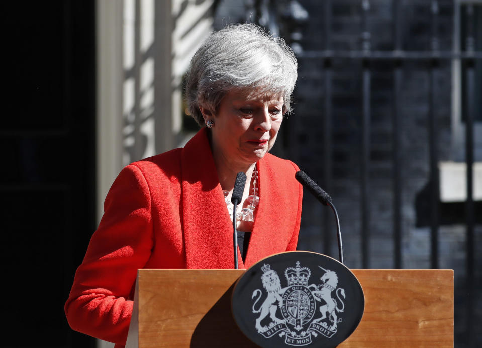 FILE - In this Friday, May 24, 2019 file photo British Prime Minister Theresa May reacts as she turns away after making a speech, saying that she would step down, in the street outside 10 Downing Street in London, England. Britain and the European Union have struck a provisional free-trade agreement that should avert New Year's chaos for cross-border commerce and bring a measure of certainty to businesses after years of Brexit turmoil. The breakthrough on Thursday, Dec. 24, 2020 came after months of tense and often testy negotiations that whittled differences down to three key issues: fair-competition rules, mechanisms for resolving future disputes and fishing rights. (AP Photo/Alastair Grant, File)