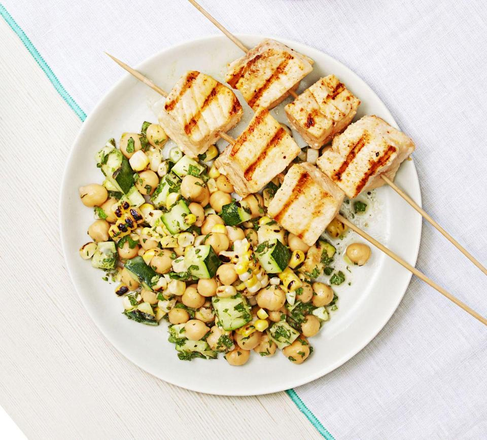 """<p>4th of July doesn't have to be all about red meat: Add swordfish steak skewers to your arsenal with this flavorful lime juice and chili powder version, paired perfectly with fresh summer corn and zucchini. </p><p><em><a href=""""https://www.goodhousekeeping.com/food-recipes/easy/a33396/swordfish-summer-salad/"""" rel=""""nofollow noopener"""" target=""""_blank"""" data-ylk=""""slk:Get the recipe for Swordfish with Summer Salad »"""" class=""""link rapid-noclick-resp"""">Get the recipe for Swordfish with Summer Salad »</a></em></p><p><strong>RELATED: </strong><a href=""""https://www.goodhousekeeping.com/food-recipes/healthy/g902/myplate-inspired-seafood-recipes/"""" rel=""""nofollow noopener"""" target=""""_blank"""" data-ylk=""""slk:30+ Healthy Fish and Seafood Recipes to Make Tonight"""" class=""""link rapid-noclick-resp"""">30+ Healthy Fish and Seafood Recipes to Make Tonight</a></p>"""