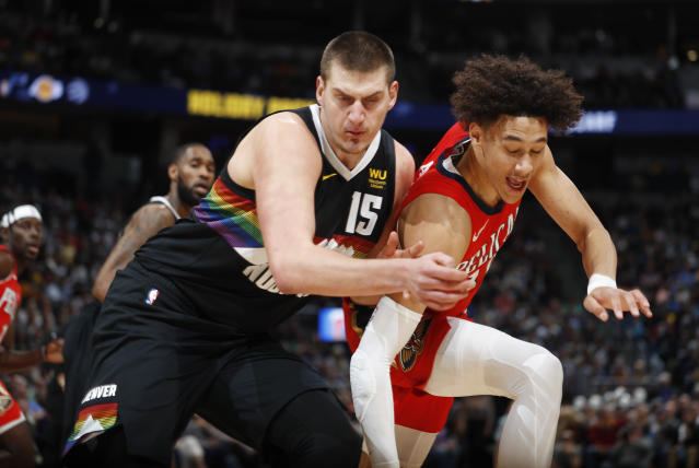 The Nuggets and center Nikola Jokic, left, came up short against the Pelicans on Wednesday night. (AP Photo/David Zalubowski)