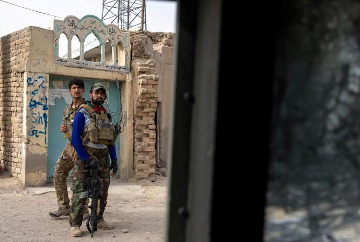 Members of the Afghan special forces regroup after heavy clashes with Taliban in Kandahar province in July.