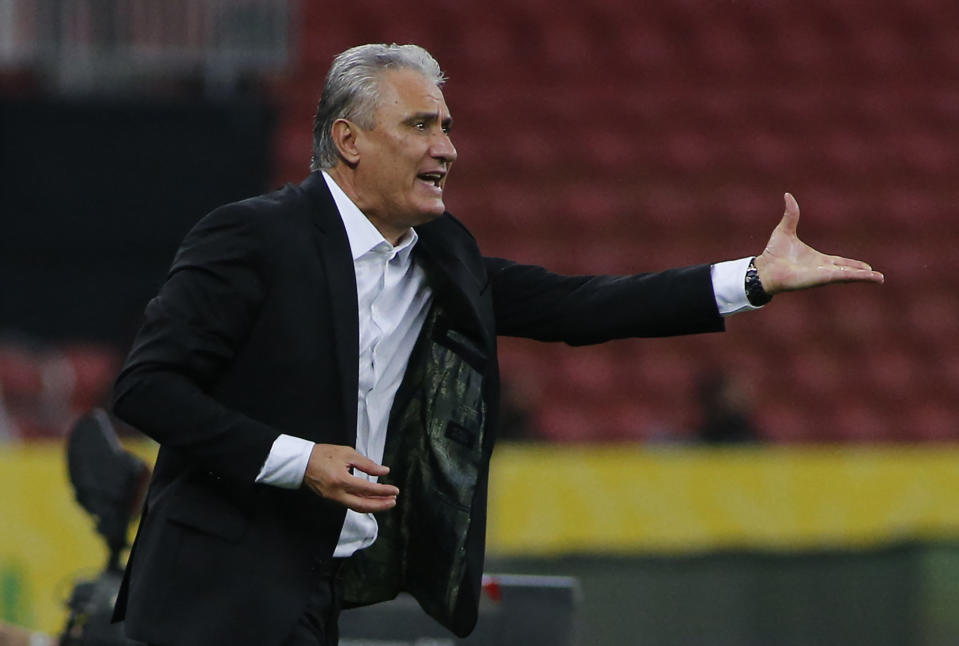 Brazil's coach Tite gestures during the South American qualification football match for the FIFA World Cup Qatar 2022 against Ecuador at the Jose Pinheiro Borda stadium, better known as Beira-Rio, in Porto Alegre, Brazil, on June 4, 2021. (Photo by SILVIO AVILA / AFP) (Photo by SILVIO AVILA/AFP via Getty Images)