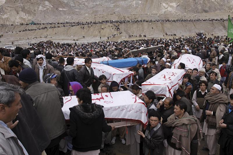 In this Wednesday, Feb. 20, 2013, photo, Pakistani Shiite Muslims carry the bodies of relatives who were killed by a bomb blast that took place in a market on Saturday, February 16, 2013, for burial in Quetta, Pakistan. Terrorized by ferocious attacks that have killed nearly 400 ethnic Hazaras in the past 18 months, with almost half of those deaths occurring in the first two months of this year, Shiite leaders blamed the inaction of Pakistan's security service for the rising violence against them in Quetta, the capital of southwestern Baluchistan province.(AP Photo/Arshad Butt)