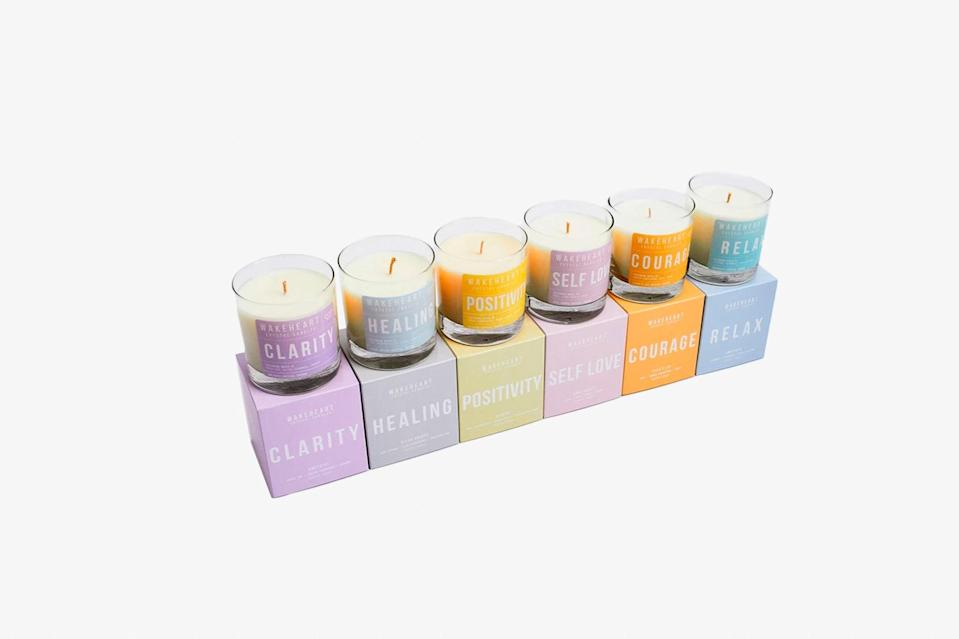 """2020 has been a terrifying and stressful year, which is why it's essential to take a few minutes to yourself every day to unwind. These Crystal Candles by Wakeheart can help bring a sense of calm to any room through their healing stones and curated scents. The line includes six candles, like Self Love, Relax, and Courage, that will help transform your atmosphere into one of pure serenity and good vibes. Each scented candle contains a unique crystal that's energy is said to help promote healing (and can be kept after the candles are done burning). $36, Wakeheart. <a href=""""https://wakeheart.com/collections/crystal-candle-collection"""" rel=""""nofollow noopener"""" target=""""_blank"""" data-ylk=""""slk:Get it now!"""" class=""""link rapid-noclick-resp"""">Get it now!</a>"""