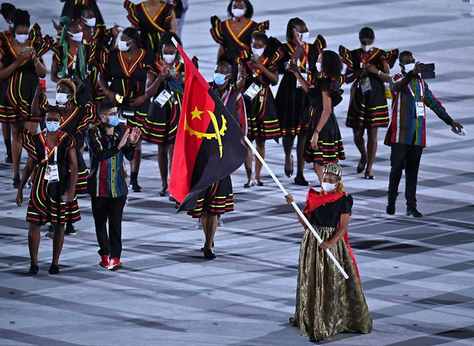 <p>Angola made the opening ceremony their runway in black dresses with red and yellow detail. </p>