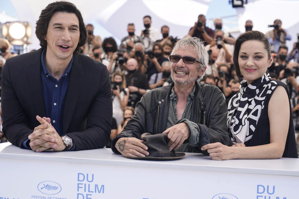 Adam Driver, from left, Marion Cotillard and director Leos Carax pose for photographers at the photo call for the film Annette at the 74th international film festival, Cannes, southern France, Tuesday, July 6, 2021. (AP Photo/Brynn Anderson)