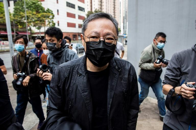 Pro-democracy activist Benny Tai arrives at a police station in Hong Kong to face a subversion charge
