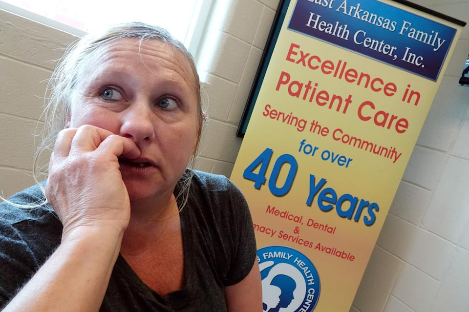 """Julie Rosamond discusses a new rule to require """"able-bodied"""" Medicaid recipients to work or volunteer for a minimum number of hours each month, or be locked out of health benefits in Lepanto, Arkansas, U.S., May 2, 2018. Picture taken May 2, 2018 .     To match Special Report USA-HEALTHCARE/ARKANSAS     REUTERS/Karen Pulfer Focht"""