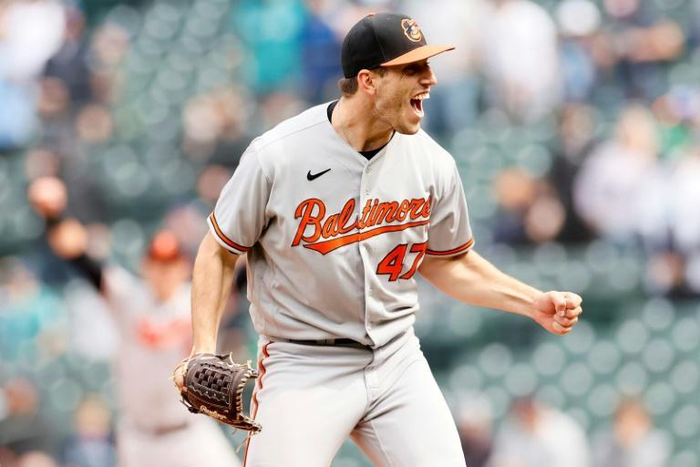 Baltimore's John Means reacts after recording the final out of his no-hitter against the Seattle Mariners