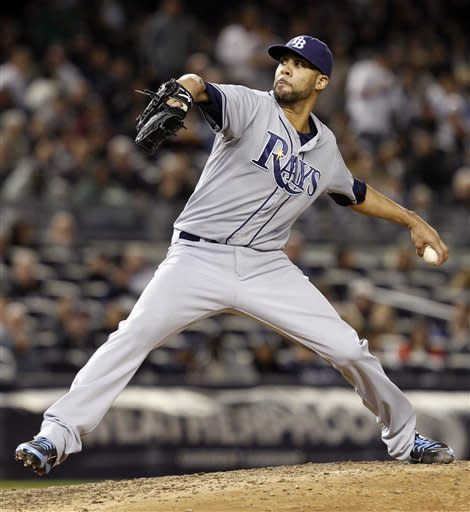 Tampa Bay Rays starting pitcher David Price winds up against the New York Yankees in the sixth inning during their baseball game at Yankee Stadium in New York, Thursday, May 10, 2012. (AP Photo/Kathy Willens)