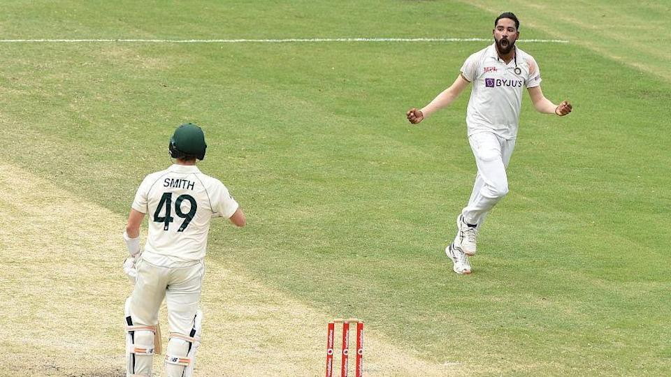 Mohammed Siraj celebrates the wicket of Steve Smith on Day 4 at the Gabba.