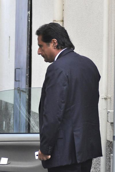 Captain Francesco Schettino arrives at the converted Teatro Moderno theater for a hearing in his trial, in Grosseto, Italy, Monday, Oct. 7, 2013. The captain of the wrecked Costa Concordia is charged with manslaughter, causing the shipwreck and abandoning ship before the luxury cruise liner's 4,200 passengers and crew could be evacuated on Jan. 13, 2012 when the ship collided with a reef off the Tuscan island of Giglio, killing 32 people. (AP Photo/Giacomo Aprili)