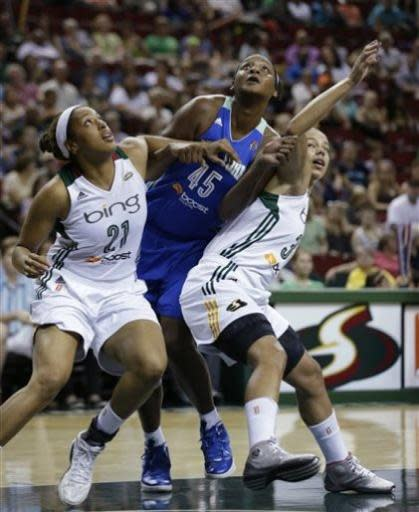 New York Liberty's Kara Braxton (45) is caught between Seattle Storm's Tianna Hawkins (21) and Alysha Clark in the first half of a WNBA basketball game, Friday, June 28, 2013, in Seattle. (AP Photo/Elaine Thompson)