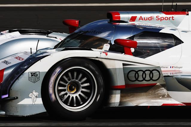LE MANS, FRANCE - JUNE 16: The Audi Sport Team Joest R18 E-Tron Quattro of Andre Lotterer, Marcel Fassler and Benoit Treluyer drives during the Le Mans 24 Hour race at the Circuit de la Sarthe on June 16, 2012 in Le Mans, France. (Photo by Ker Robertson/Getty Images)