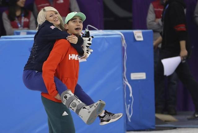 Short Track Speed Skating Events - Pyeongchang 2018 Winter Olympics - Men's 5000m Relay Final - Gangneung Ice Arena - Gangneung, South Korea - February 22, 2018 - Short track speed skater Elise Christie of Britain rides piggyback on on gold medallist Sandor Liu Shaolin of Hungary. REUTERS/Lucy Nicholson TPX IMAGES OF THE DAY