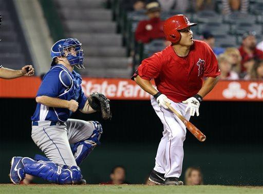 Los Angeles Dodgers catcher John Hester, left, watches as Los Angeles Angels' Hank Conger follow through for his walk off home run in the ninth inning of an exhibition baseball game in Anaheim, Calif., on Saturday, March 30, 2013. The Angels won 2-1. (AP Photo/Christine Cotter)