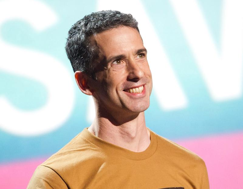 FILE - In this June 13, 2011 file photo, Dan Savage appears onstage at the 15th Annual Webby Awards in New York. TakePart TV, a brand-new YouTube channel launching Tuesday, Oct. 2, 2012m, will deliver original programming that consists of news, short-form comedy, animation and nonfiction series featuring such names as Henry Rollins, Dan Savage and Kobe Bryant. (AP Photo/Charles Sykes, File)