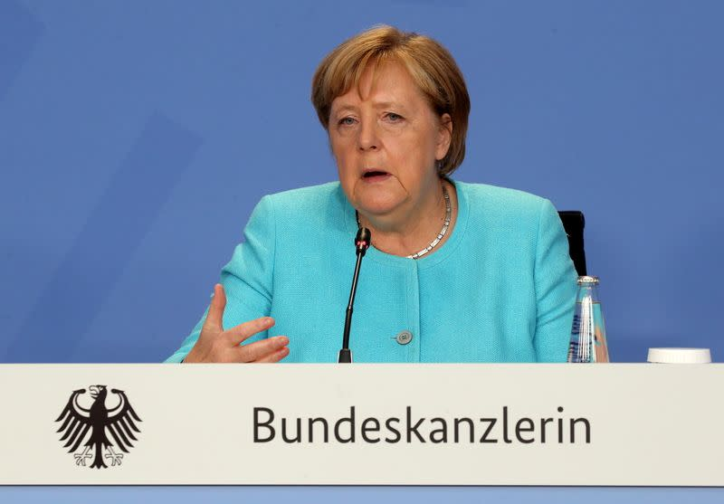FILE PHOTO: German Chancellor Merkel attends a news conference