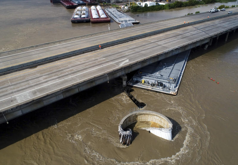 Interstate 10 at the San Jacinto River was shut down in both directions after multiple barges collided with the bridge Friday, Sept. 20, 2019, in Houston, in the aftermath of Tropical Storm Imelda. (Godofredo A. Vasquez/Houston Chronicle via AP)