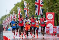 <p>Three pace runners lead Eliud Kipchoge around as they compete in the 2020 Virgin Money London Marathon</p>