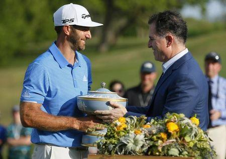 Mar 26, 2017; Austin, TX, USA; Dustin Johnson of the United States receives The Walter Hagen Trophy from Michael Dell, CEO and founder of Dell Technologies, after beating Jon Rahm of Spain in the final round of the World Golf Classic - Dell Match Play golf tournament at Austin Country Club. Mandatory Credit: Erich Schlegel-USA TODAY Sports