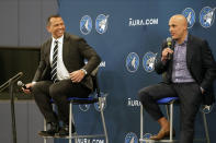 Minnesota Timberwolves new owners Marc Lore, right, and baseball great Alex Rodriguez, left, address the media after current owner Glen Taylor introduced them during a news conference for the NBA Timberwolves basketball team, Monday, Sept. 27, 2021, in Minneapolis. (AP Photo/Jim Mone)