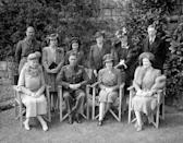 <p>The royals pose for a family portrait outdoors. Queen Mary, King George VI, Princess Elizabeth, and Elizabeth the Queen Mother are seated in the front row, while the Duke and Duchess of Gloucester, Princess Margaret, Princess Mary the Countess of Harewood, the Duchess of Kent, and Henry Lascelles, 6th Earl of Harewood stand behind them.</p>