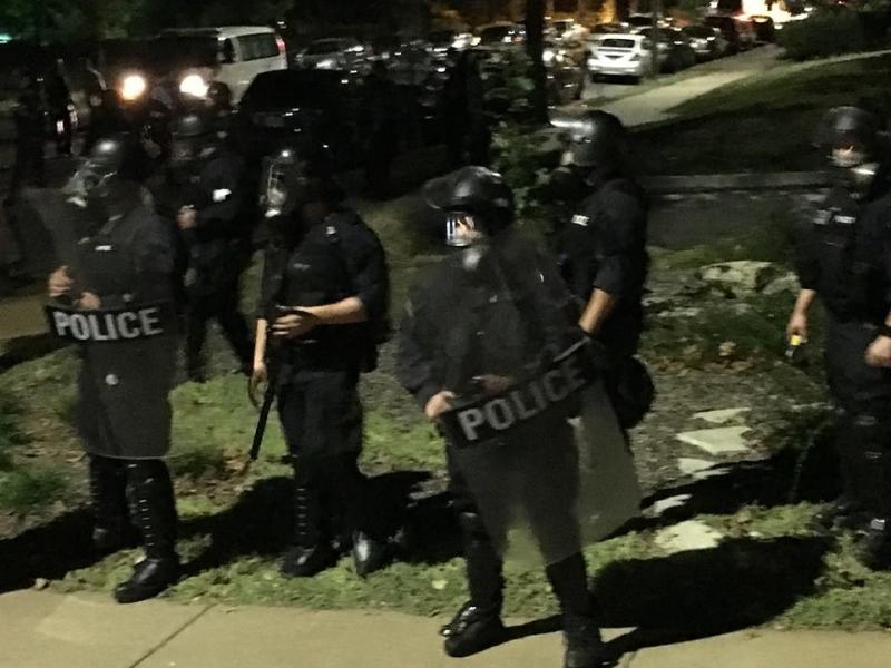 Riot police are seen in St. Louis on Sept. 15. (Lynn Hunt)