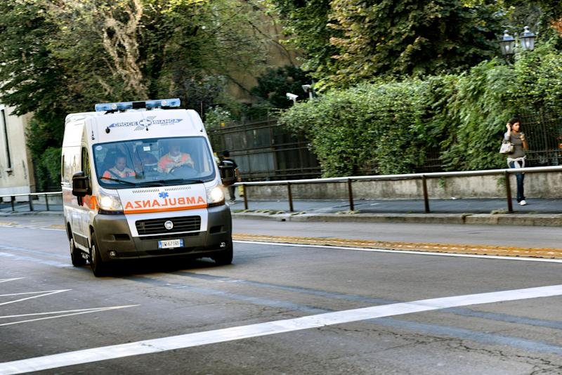 Milan, Italy - September 14, 2012: An ambulance with three paramedics is running fast in Milan city centre street for an emergency call. A woman on the right is walking and looking at her mobile phone. (Photo: ilbusca via Getty Images)