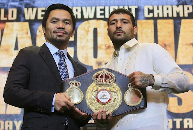 "Philippine senator and boxing icon Manny ""Pacman"" Pacquiao (L) poses for a picture with welterweight world title holder Lucas Matthysse, for their upcoming WBA ""regular"" welterweight title fight in Kuala Lumpur, Malaysia, during a news conference in a hotel in Paranaque city, metro Manila, Philippines April 18, 2018. REUTERS/Romeo Ranoco"
