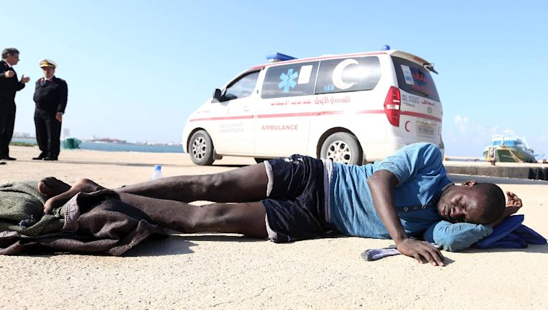 A man who was rescued with fellow migrants by the Libyan coastguard in the Mediterranean Sea rests at the naval base in the capital Tripoli on December 21, 2015 (AFP Photo/Mahmud Turkia)