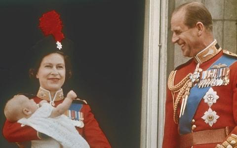 Queen Elizabeth, holding the infant Prince Edward, with Prince Philip, on the balcony at Buckingham Palace during the Trooping of the Colour, London, 13th June 1964 - Credit: Gamma-Keystone/Keystone-France