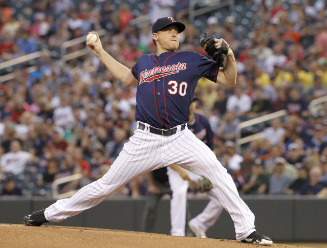 Minnesota Twins starting pitcher Kevin Correia delivers to the Chicago White Sox during the first inning of a baseball game in Minneapolis, Friday, July 25, 2014. (AP Photo/Ann Heisenfelt)