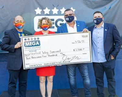 United Way Suncoast, Luis Visot, Senior Director, and Kari Goetz, Chief Advancement Officer received a $2,500 check from Mega Service Solutions, Eddie Mejia, President, and John Mejia, Chief Executive Officer.