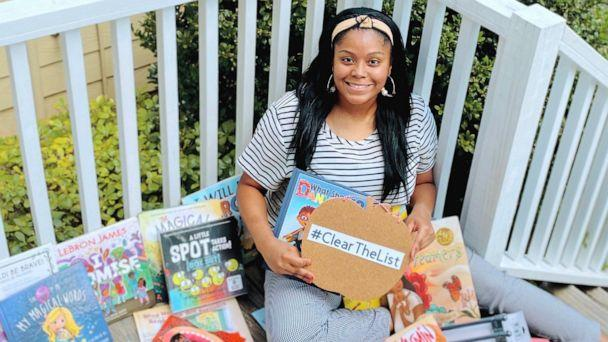 PHOTO: Kayla Richardson, a 4th grade ESL teacher in Texas, poses with children's books she received from Chrissy Teigen. (Courtesy Kayla Richardson)