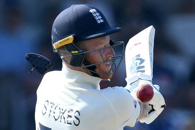 That was close! Pieces fly off of the helmet of Ben Stokes after the ball hit him in the head (AFP Photo/Paul ELLIS)