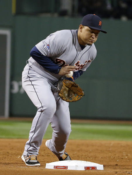 Detroit Tigers third baseman Miguel Cabrera fields a ground ball hit by Boston Red Sox's Dustin Peoria before turning a double play in the third inning during Game 6 of the American League baseball championship series on Saturday, Oct. 19, 2013, in Boston. (AP Photo/Matt Slocum)