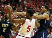 Pittsburgh's Derrick Randall (11) and Indiana's Troy Williams (5) battle for a rebound during the first half of an NCAA college basketball game Tuesday, Dec. 2, 2014, in Bloomington, Ind. (AP Photo/Darron Cummings)