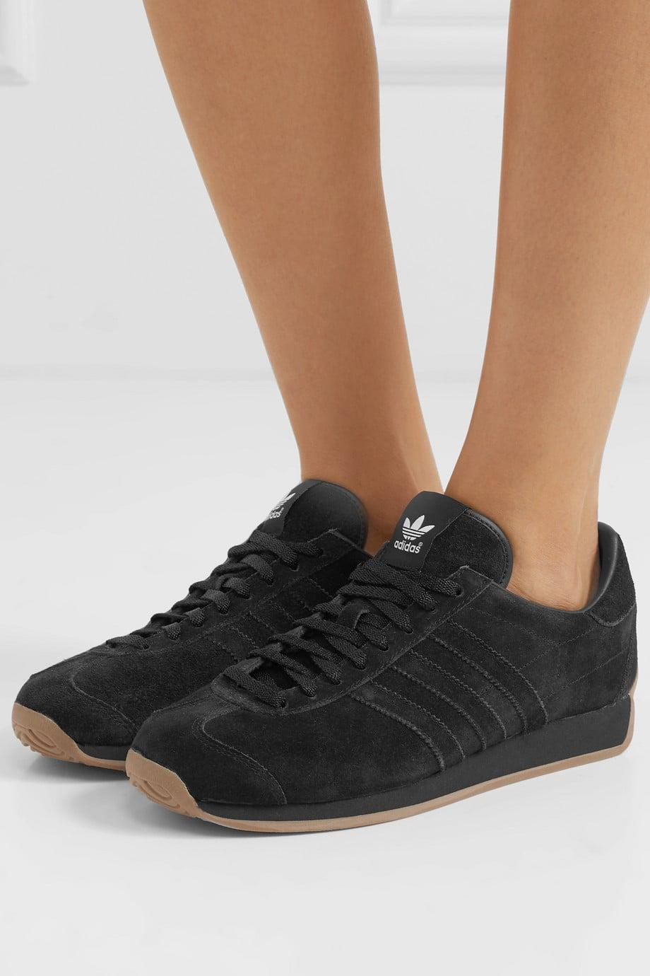 "<p><a href=""https://www.popsugar.com/buy/Khaite---Adidas-Originals-suede-Sneakers-509671?p_name=Khaite%20-%20%2B%20Adidas%20Originals%20suede%20Sneakers&retailer=net-a-porter.com&pid=509671&price=200&evar1=fab%3Aus&evar9=44311634&evar98=https%3A%2F%2Fwww.popsugar.com%2Ffashion%2Fphoto-gallery%2F44311634%2Fimage%2F46920956%2FKhaite---Adidas-Originals-suede-Sneakers&list1=shopping%2Cshoes%2Csneakers%2Choliday%2Cgift%20guide%2Ceditors%20pick%2Cfashion%20gifts%2Cgifts%20for%20women&prop13=api&pdata=1"" class=""link rapid-noclick-resp"" rel=""nofollow noopener"" target=""_blank"" data-ylk=""slk:Khaite - + Adidas Originals suede Sneakers"">Khaite - + Adidas Originals suede Sneakers</a> ($200)</p> <p>""I first noticed these sneakers when <a class=""link rapid-noclick-resp"" href=""https://www.popsugar.com/Katie-Holmes"" rel=""nofollow noopener"" target=""_blank"" data-ylk=""slk:Katie Holmes"">Katie Holmes</a> was spotted wearing them out and about. The monochromatic all-black look is sleek yet wearable."" - Lisa Sugar, founder and president, POPSUGAR</p>"