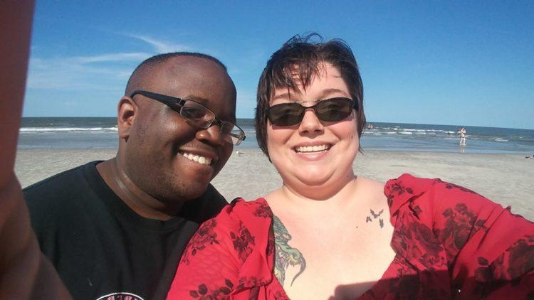 Couple smiling selfie on the beach