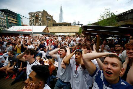 England soccer fans watch the team's first match in the World Cup against Tunisia at Flat Iron Square in London, Britain, June 18, 2018. REUTERS/Henry Nicholls